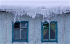 The roof of a house is covered with snow in the village of Tomtor in the Oymyakon valley