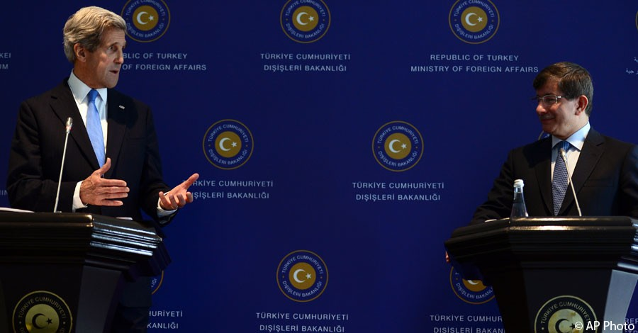 U.S. Secretary of State John Kerry, left, speaks during a news conference with his Turkish counterpart, Foreign Minister Ahmet Davutoglu, in Istanbul, Turkey, April 7, 2013. [AP Photo]