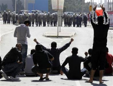 Bahrain youths demonstrate in front of the police in Manama, February 14, 2011. S REUTERS/Hamad I Mohammed