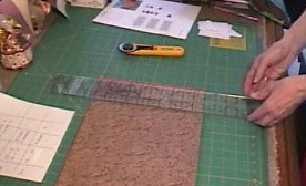 lay ruler on fabric to cut