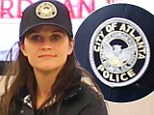 She's wearing WHAT? Reese Witherspoon sports a City of Atlanta Police baseball cap as she smirks upon arrival to Los Angeles