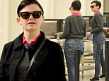 Roomy fit: Ginnifer Goodwin donned a baggy pair of high-waisted denim pants for her day of travel
