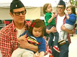 His hands are full! Doting dad Johnny Knoxville carries adorable tots Rocko and Arlo as family heads to farmers market
