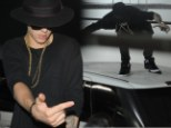 Rooftop dancing: Justin Bieber busted a move on the roof of a vehicle in Dubai on Friday while in the United Arab Emirates for his international Believe Tour