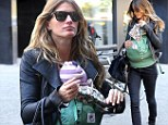 Baby on board! Gisele's daughter Vivian Lake travels in style with her doting model mother