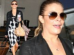 'Headed home to my fam': LeAnn Rimes makes LAX terminal her personal runway in a pin-baring tie-dye dress