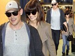 Riders of the storm: Glee stars Lea Michele and Cory Monteith fly home after his post-rehab vacation