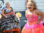 Here comes the bride (in camouflage)! Mama June wears bizarre wedding dress as she heads down the aisle... while Honey Boo Boo is pretty in pink