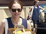 Armed and dangerous! Natalie Portman shows off some seriously toned shoulders while shopping for healthy groceries