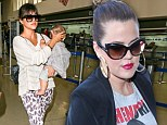 Fierce fliers! Khloe and Kourtney Kardashian channel their inner felines as they sport cat-like accessories while travelling through Los Angeles airport