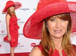 Ravishing in red! Jane Seymour cuts a solo figure as she dazzles at the Kentucky Derby without estranged husband James Keach