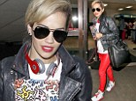 Rita Ora looks fab as she lands in LAX in a pair of bright red trousers