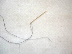 thread a needle to join the batting