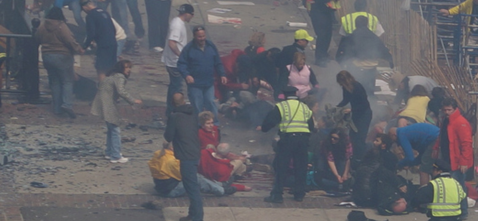 Boston Marathon first explosion hahatango Zahirs-crop for Superhero Cowboy t04-11-00 e01m16s d02-51-14 F14 Cowboy crouching at the fence Woman in brown sweatshirt more forward stageleft