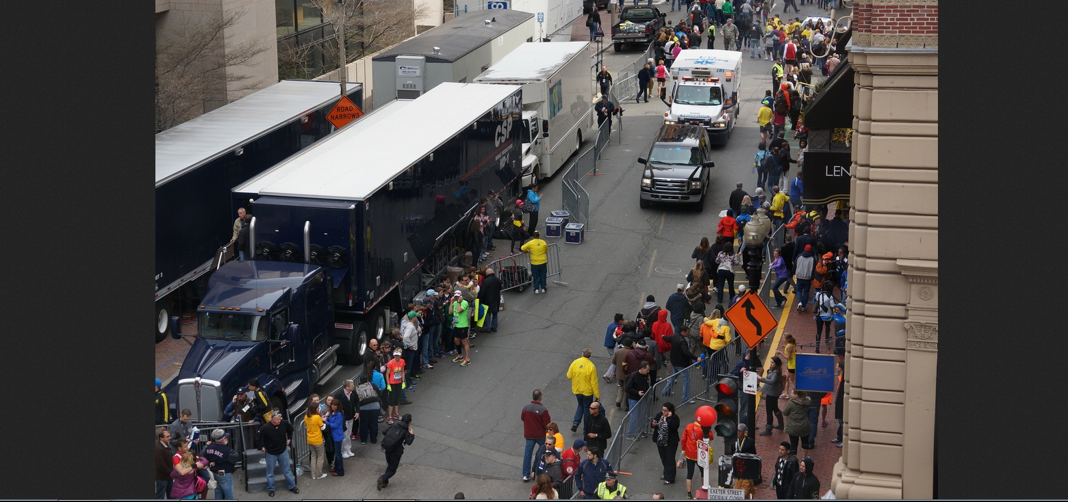 Boston Marathon first explosion hahatango Zahirs-crop for Superhero Cowboy t04-12-54m e03m10s d02-53-08 F29 Ambulance approaching rightside