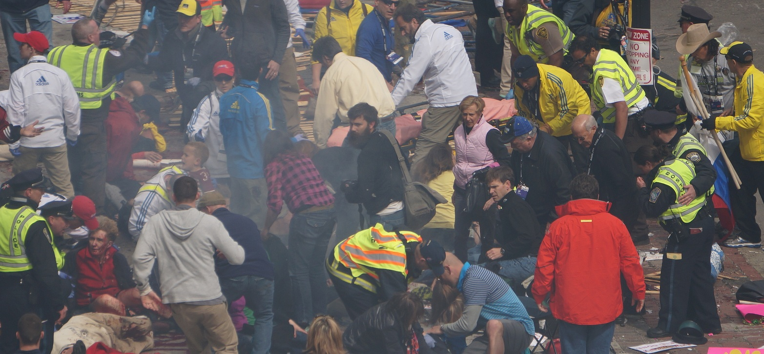 Boston Marathon first explosion hahatango Zahirs-crop for Superhero Cowboy t04-12-21m e02m37s d02-52-34 F26 Gurney still empty Cowboy still standing around