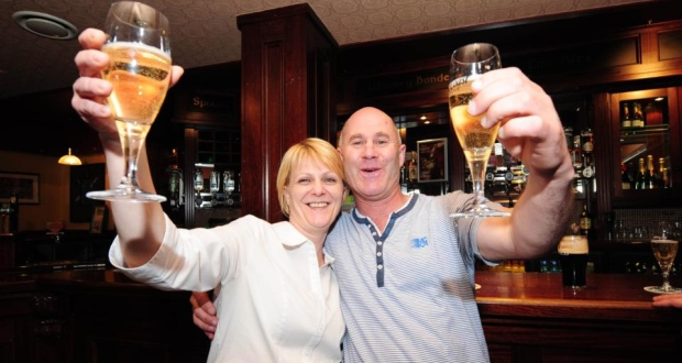 Lotto winners Kevin Geogeghan and Carol Loran celebrating in Dolan's Bar, Mullingar. Photograph: James Flynn/APX
