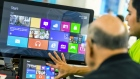 An employee at a Microsoft store explains the Windows 8 operating system last year.
