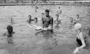 Lifeguard teaching boy to swim,Highland Park swimming pool 1951
