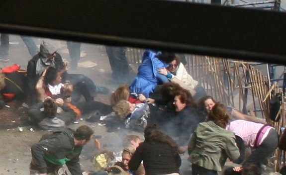 Boston Marathon Bombing Jeff Bauman's strange three victim huddle scene f4 via bbmisc-20697-boston-bombing-act