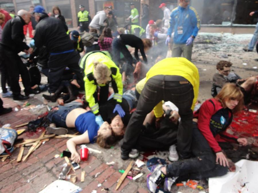Boston Marathon dead girl in blue (Krystle?) being attended but legless man who is still alive being ignored. Image via LiveLeak.com