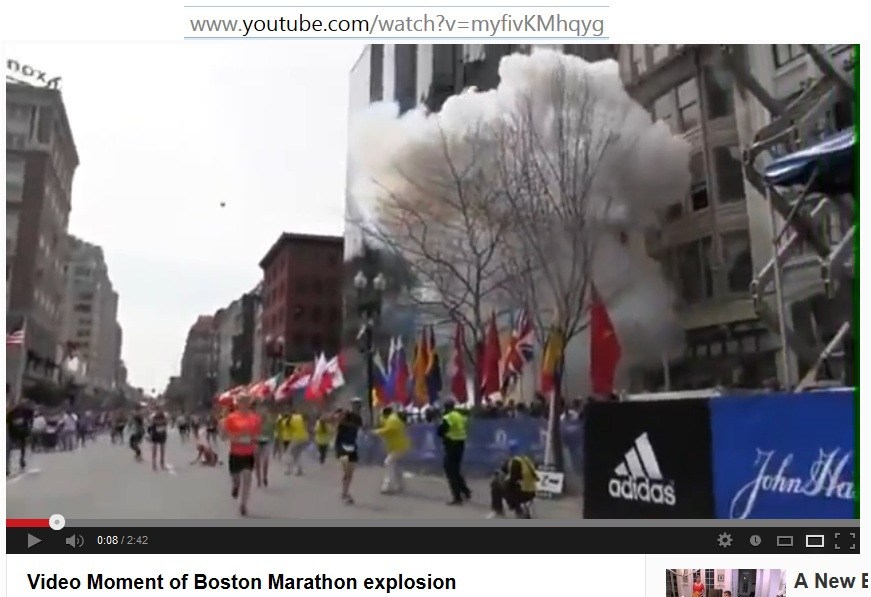 Video Image Explosion at Boston Marathon F2 First Explosion Smoke Rising v00-00-08 t04-09-46i