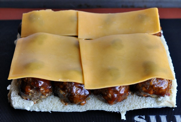 Smokey Mesquite BBQ Sliders topped with cheddar cheese