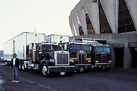 A row of G. D. Productions Big Rig Tractor Trailer Trucks parked in back of the Hampton Coliseum. Scenes before the Second Warlocks Show. The Grateful Dead Live at The Hampton Coliseum 9 October 1989. My old friend Glenn Lally stands beside.