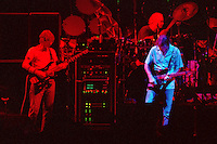 """Phil Lesh, Bob Weir and Bill Kreutzmann performing with The Grateful Dead Live at The Hampton Coliseum on 8 October 1989. One of the """"Formerly The Warlocks"""" concerts. Image capture during """"Dark Star"""". Limited Edition Photographic Prints available for purchase in Cart."""