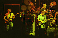"""Phil Lesh, Bob Weir and Bill Kreutzmann performing with The Grateful Dead Live at The Hampton Coliseum on 8 October 1989.  One of the """"Formerly The Warlocks"""" concerts. Limited Edition Photographic Prints available for purchase in Cart."""