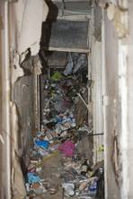 Hoarder feared dead when living room ceiling caves in under 'at least 20 tonnes of rubbish'