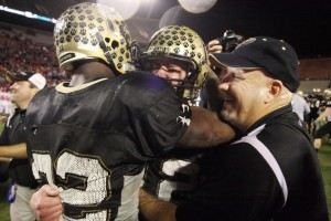 L-R James Wilder, Phillip Ely and Coach Weiner, Celebrate Winning Plant's 3rd State Championship