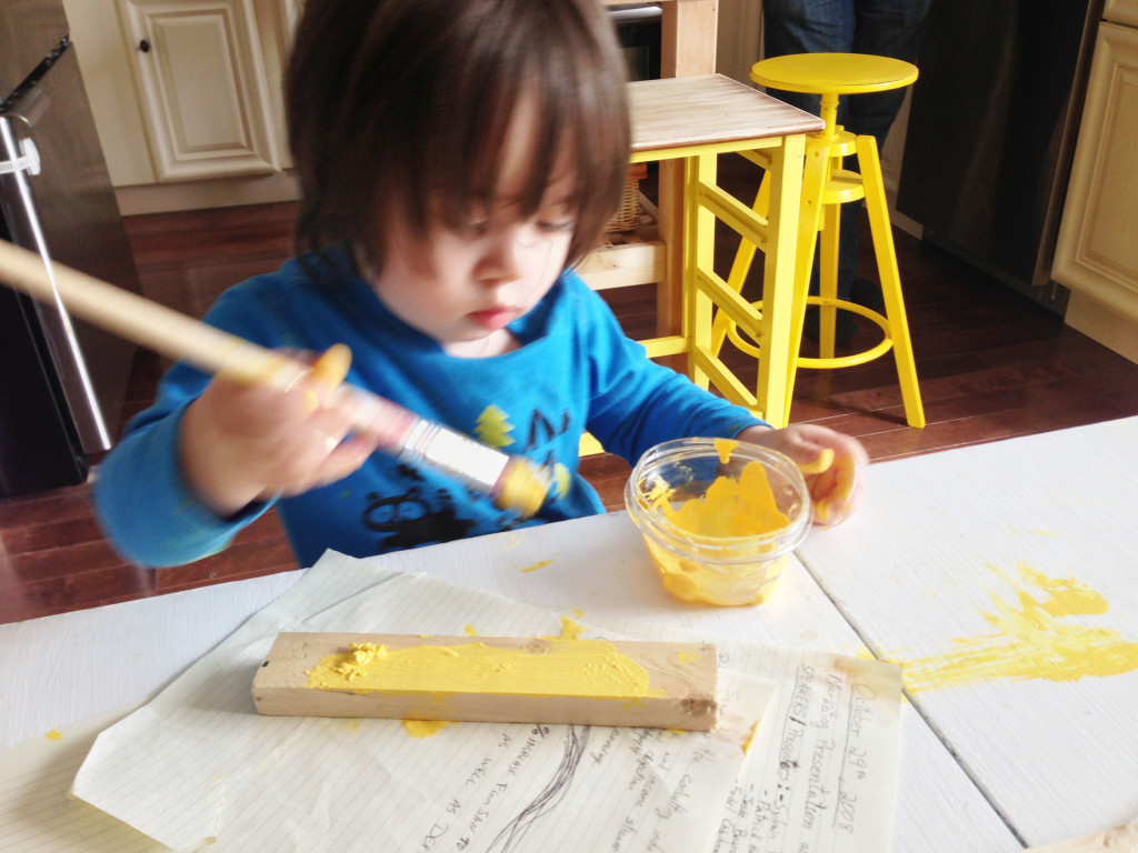 Nate painting with mommy www.nowathomemom.comDIY mini kitchen island yellow- 17-maybe