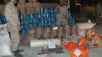 Pakistani paramilitary soldiers stand beside seized bomb making material in Quetta on 20 August 2013.