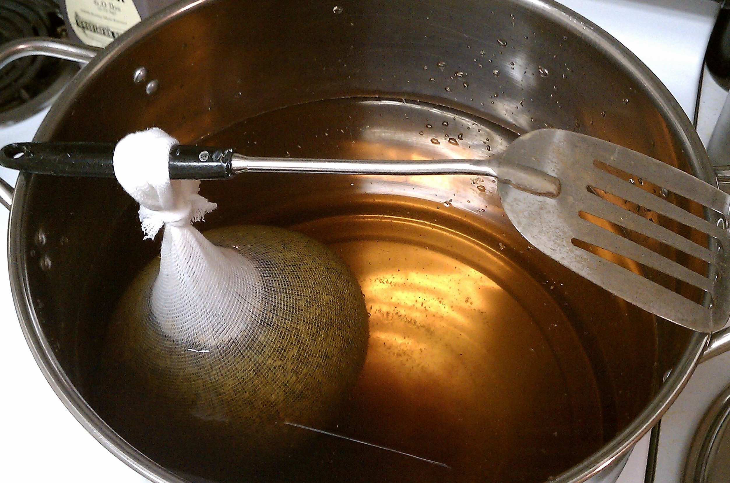 Steeping the specialty grains. Also, note the level of the water.