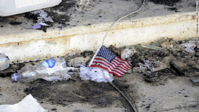 A small American flag is seen in the rubble at the U.S. Consulate on September 12.