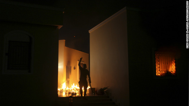 A protester reacts as the U.S. Consulate in Benghazi burns on September 11.