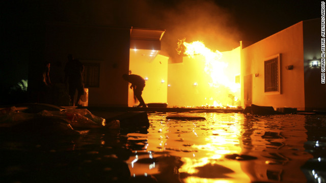 People duck flames outside a consulate building on September 11.