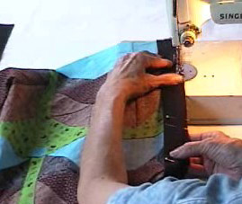 sew the border strip onto the quilt