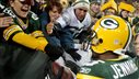 Image: Green Bay Packers wide receiver Jennings celebrates a touchdown against the Dallas Cowboys with fans in the first half during their NFL football game in Green Bay