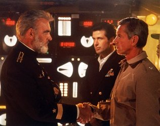"""FILE - This undated file image provided by Paramount Studios shows a scene from """"The Hunt for Red October"""" starring, from left, Sean Connery, Alec Baldwin and Scott Glenn. The film is based on the book by Tom Clancy. Clancy, the bestselling author of """"The Hunt for Red October"""" and other wildly successful technological thrillers, has died. He was 66. Penguin Group (USA) said Wednesday, Oct. 2, 2013, that Clancy died Tuesday in Baltimore. The publisher did not disclose a cause of death."""