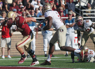 Boston College tight end Jake Sinkovec (41) runs into the end zone for a touchdown past Florida State linebacker Christian Jones (7), defensive back Terrence Brooks (31) and linebacker Telvin Smith (22) during the first quarter of an NCAA college football game at Alumni Stadium in Boston, Saturday, Sept. 28, 2013. (AP Photo/Elise Amendola)