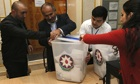 Members of Azerbaijan's electoral commission prepare to count ballots at a polling station in Baku