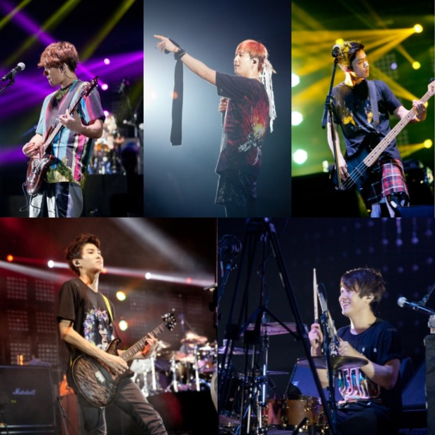 """Clockwise from top left, K-pop band FTISLAND members Choi Jong-hoon, Lee Hong-gi, Lee Jae-jin, Choi Min-hwan and Song Seung-hyun perform during their Asia concert tour """"TAKE FTISLAND,"""" held at the Asia World Expo in Hong Kong on August 18, 2013. [FNC Entertainment]"""