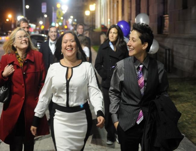 Gabriela Cristina Celeiro, left, and Elizabeth C. Salerno enter Newark City Hall Sunday night in anticipation of getting married.