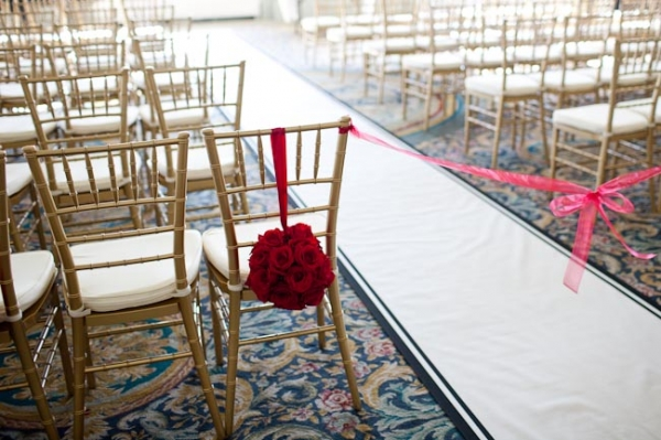 gold-chivalri-chairs-red-pomanders-ceremony