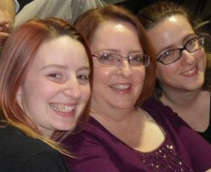 My sister, mother, and me at the Rock and Worship Roadshow in November 2011.