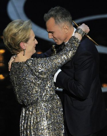 """Meryl Streep, left, presents the award for best actor in a leading role to Daniel Day-Lewis for """"Lincoln"""" during the Oscars at the Dolby Theatre on Sunday, Feb. 24, 2013, in Los Angeles. (Photo by Chris Pizzello/Invision/AP) Photo: Chris Pizzello, Associated Press"""
