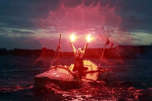 Solo rower Mylene Paquette celebrates after crossing the Atlantic.  REUTERS/Stephane Mahe