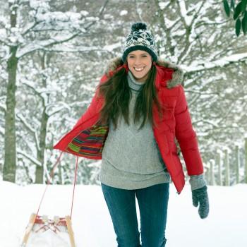 Sledding-woman-winter